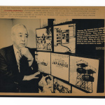 George Kondo near a display of photographs taken at incarceration camps during World War II