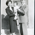 Photograph of Jean and Togo Tanaka with daughter Iye posing in front of a door in Cow Creek Camp in Death Valley