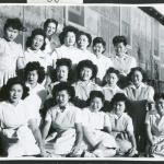 Photograph of Dagmar Quarnstrom and the hospital staff aides in front of the Manzanar hospital